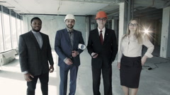 A team of specialists before starting works on finishing the hall - stock footage