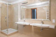 Shower and two washbasins - stock photo