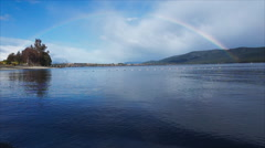 Rainbow over lake Te Anau, New Zealand Stock Footage