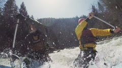 Sport catamaran is fused on the rapid river with two persons. Slow motion Stock Footage
