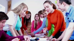 A group of people actively working in the office on technical task. - stock footage