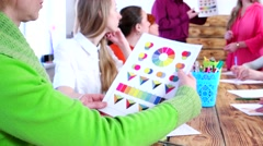 A company that sells printers demonstrates color print quality for customers. - stock footage
