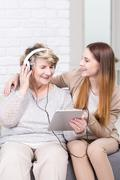 Never too late to listen to latest hits - stock photo
