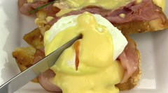 Slicing Eggs Benedict With A Knife - stock footage