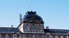FRANCE, PARIS: French flag in the wind above the Louvre museum roof Stock Footage