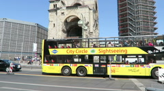 Bus passing by Berlin city west with traffic and tourists Stock Footage