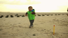 First steps a baby at the beach Stock Footage