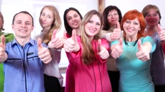 Group of happy people showing thumbs up in approval and encouragements sign. - stock footage
