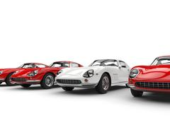 Vintage sports cars - white stands out in a row of red cars Stock Illustration