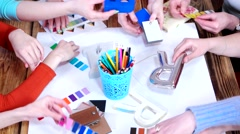 Hands designers with models of letters color palettes colored pencils. Stock Footage