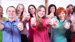 Successful young intelligent and beautiful people give thumbs up and smiling. Stock Footage