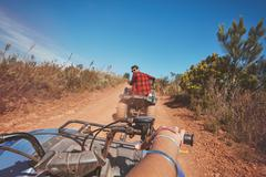 Young man driving ATV in nature Stock Photos