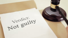 Not Guilty title on Legal Documents with gavel Stock Footage