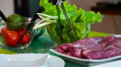 Meat tenderloin and vegetables on the table Stock Footage