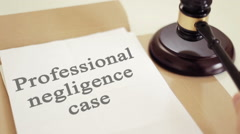 Professional negligence case titled on legal documents Stock Footage