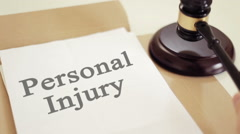 Personal injury titled on legal documents Stock Footage