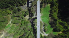 4K Graphic aerial shot of cars on a bridge - stock footage