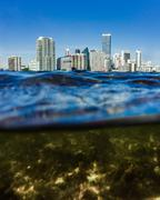 Downtown Miami skyline from below the water - stock photo