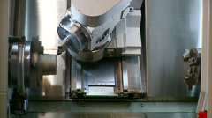 Metallurgical industrial factory: a machine milling a piece. Stock Footage
