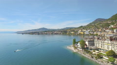 4K aerial shot of a lovely swiss city surrounded by nature Stock Footage
