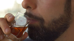 Detail of man with a beard while drinking a shot Stock Footage