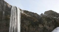 Slowmotion Seljalandsfoss waterfall tilt shot Stock Footage