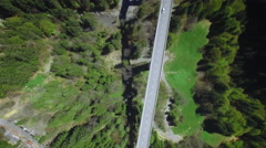 4K slow rotation aerial shot of a car on a bridge Stock Footage