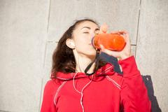 Runner woman with bottle drink Stock Photos