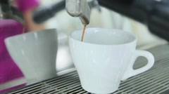 Coffee from coffee machine is poured into coffee Stock Footage