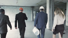 Investor accompanied by his advisers left the building after the inspection Stock Footage