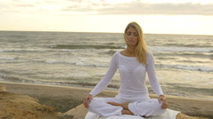 Yoga : Lotus position by the sea Stock Footage