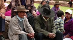 PERU: People watching a traditional procession in the village of Chincheros Stock Footage