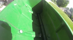 Filling Lawn Spreader with Weed Killer / Fertilizer Stock Footage