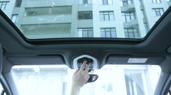 Man closes hatch in the car Stock Footage