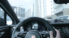 Driving car in the city first person view Stock Footage