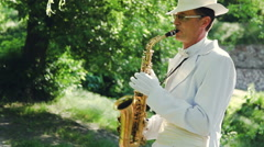 Saxophonist in nature. Video Series. Stock Footage