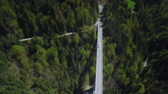 4K aerial shot of a truck / lorry driving on a long straight bridge Stock Footage