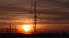 Time lapse of electrical towers with a sunset Stock Footage