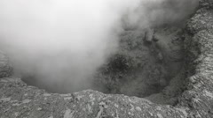 Volcanic activity: boiling thermal mud pot in crater of active volcano Stock Footage