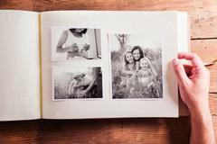Mothers day composition. Photo album, black-and-white pictures - stock photo