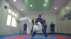 Aikido instructor and his students,attractive throw by Sheyno,slow motion,crane Stock Footage