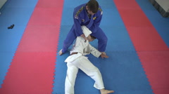 Aikido instructor throwing student by Pakito,slow motion,crane shot. Stock Footage