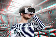 Man wearing virtual reality goggles. Welding factory - stock photo