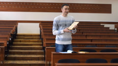 The student leads the discussion with the teacher in the lecture hall Stock Footage