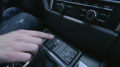 Man presses button on car's dashboard - stock footage