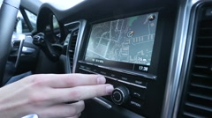 Man uses a navigator in the car Stock Footage