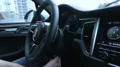 Man adjusts the position of the steering wheel in the car Stock Footage