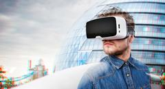 Man wearing virtual reality goggles. London, England - stock photo