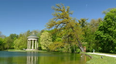 Apollo temple in Nymphenburg Park Lake Coots Goose Munich Germany Stock Footage