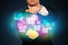 man holding abstract icons - stock photo
